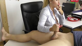 Busty Miss Lonelyhearts gives her boss a handjob at the office while smoking